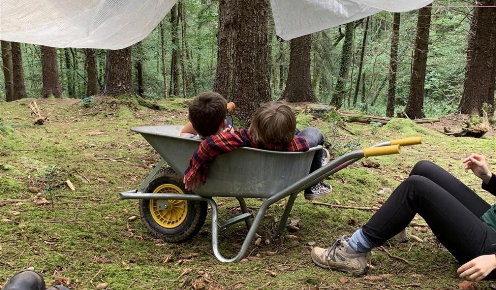 Children in wheelbarrow