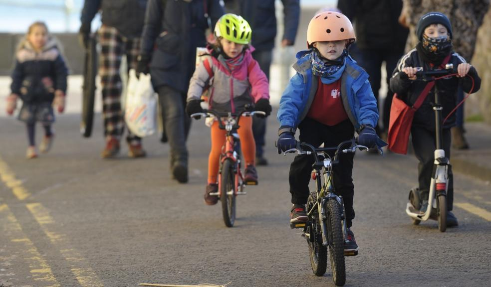 Children walking, cycling and scooting to school