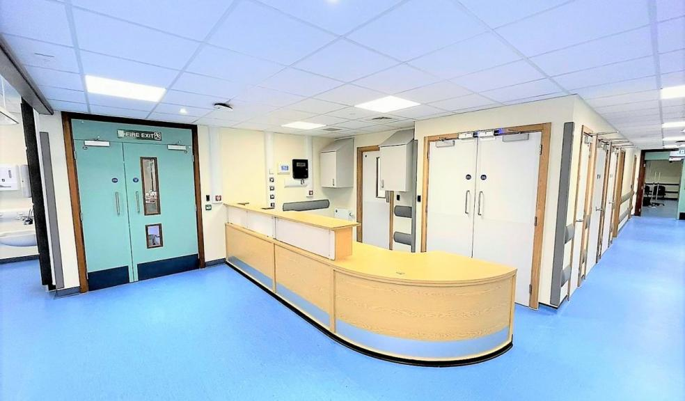 Hospital corridor with blue floor.