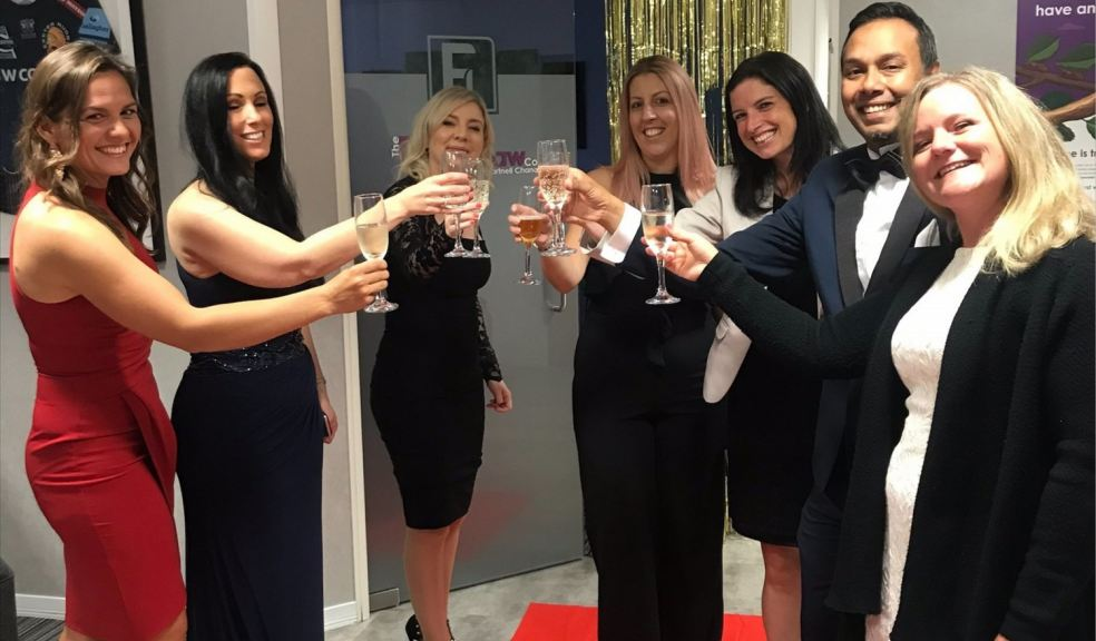 Group of lawyers toasting with a glass of fizz