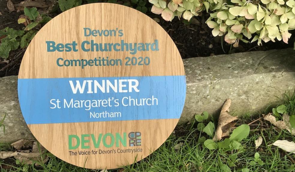 Devon's Best Churchyard 2020 winner's plaque in the churchyard at Northam