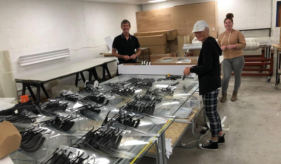 ADS Window Films: volunteers and staff producing visors