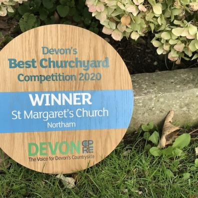 Devon's Best Churchyard 2020 winner's plaque in the churchyard at Northam