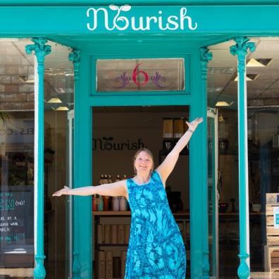 Woman standing outside shop