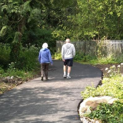 Couple walking along traffic-free pth
