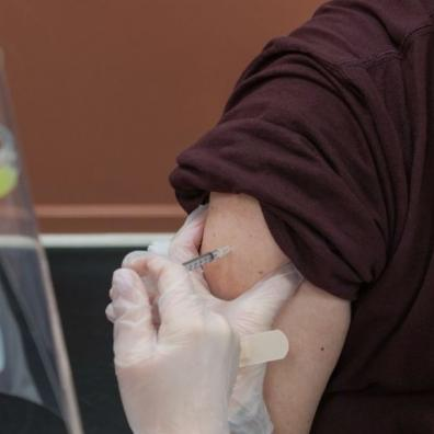 An image showing a person receiving a vaccination jab in the arm